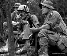 South Vietnam, December 24, 1970: Just in from the field, soldiers from D Company, 1st Battalion, 506th Infantry relax at a landing zone near Forward Support Base Jack before moving on to Camp Evans for a Christmas treat of a shower, mail call and a hot meal. (Dan Evans ©Stars and Stripes) #history #VietnamWar #Vietnam #military