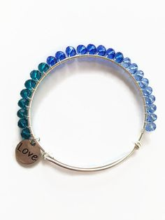 Blue Ombre Expandable Bracelet Blue Crystal Wire Wrapped Silver Expandable Bangle Stacking Bracelet Adjustable Bracelet Wire Bangle (JB73) by JulemiJewelry on Etsy https://www.etsy.com/listing/186284267/blue-ombre-expandable-bracelet-blue