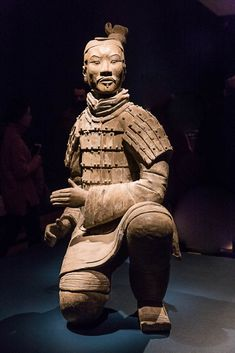 This kneeling archer originally had a crossbow in his hands. His hair is tied up in a signature topknot, his face extremely expressive. Virginia Museum of Fine Arts Crossbow, Museum Of Fine Arts, His Hands, Top Knot, Archer, Buddha, Batman, Statue, Superhero