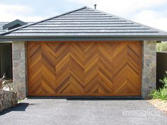 Timber Tilt Door Consisting Of Western Red Cedar Finished In A Herring Bone  Pattern