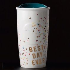 """Best Day Ever Confetti traveler Starbucks. Double-walled ceramic mug with a flutter of confetti and a good attitude. Adorned with a burst of real gold confetti, this mug and its message inspire you to find the good in each day. """"BEST DAY EVER"""" printed below the mug's raised center dot. Double wall construction helps keep coffee hot while hands stay cool, and its blue ceramic press-in lid with silicone seal minimizes spills. 12oz. Handwash. X microwave. X trade or pp.  comment below & I will…"""