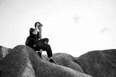 Person Sitting on Rocks Taking Photos  Free Stock Photo