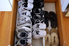 Use tension rods in a drawer (under a bed?) to store shoes.  I like this