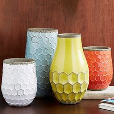 These honeycomb terracotta Hive Vases are hand-painted and glazed in happy hues. Fill them with fresh bouquets or flowering branch...