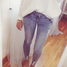 White sweater , Light wash jeans