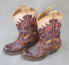 Some little cowboy most likely SLEPT in these every night! Quality leather...quality soles and workmanship...you'll NEVER see that in an off the rack boot for a child...again. These are darling, Roy Rogers brand boots from the 1930's. At Cayuse in Jackson, Wyoming.