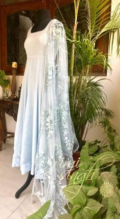 Simple indian suits - Elegance is the only beauty that never fades Powder blue crepe anarkali with matching churidaar The neckline has sequin embroidery on it It is teamed with a matching net dupatta with thread and s Pakistani Outfits, Indian Outfits, Indian Designer Outfits, Designer Dresses, Simple Dresses, Nice Dresses, Simple Indian Suits, Simple Dress Pattern, Indian Gowns Dresses