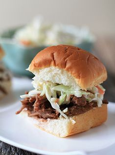 Super Bowl BBQ Beef recipe. Toss it into the crock pot Sunday morning, and you'll have the men drooling by game time. I served these up slider style on mini buns with a dollop of homemade cole slaw and alongside potato chips.