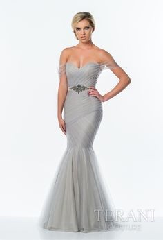 Terani Prom 2015 Collection @ Rubie&Jane in Lufkin, TX. Soft tulle off the shoulder trumpet gown featuring a drop waist bodice with pleated mesh-wrap detail, crystal embellished waistline and flared mesh skirt. Come see us at Rubie&Jane for Prom 2015!