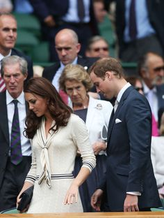 Catherine, Duchess of Cambridge and Prince William, Duke of Cambridge leave the Royal Box on Centre Court as rain delays play during day nine of the Wimbledon Lawn Tennis Championships at the All England Lawn Tennis and Croquet Club on July 4, 2012 in London, England.