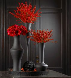 Touch of red in my gray bathroom.I can use spray paint in mat on vases. i am doing this!