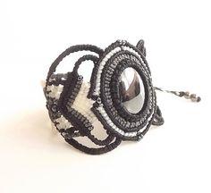 Macrame Bracelet, Boho Bracelet, Hemalyke with Black, Gray, And White Thread by neferknots on Etsy https://www.etsy.com/listing/252326064/macrame-bracelet-boho-bracelet-hemalyke