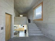 http://www.ignant.de/2016/05/30/a-concrete-villa-in-the-swiss-alps/