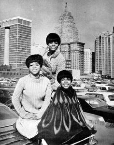The Supremes pose for a photo in a parking lot in Detroit, 1966.