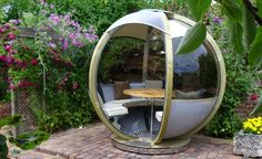 G-POD: Your futuristic garden lounge or portable office has landed. - Rotating Seater is an outdoor pod that can comfortably accommodate 5 guests and features the flexibility of 360°degree rotation.