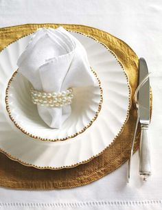 Pearl napkin rings for shabby chic wedding.