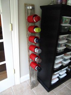 coffee cans attached to a board. color code them for personal identification