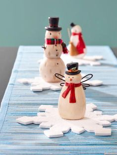 Three ceramic snowmen make a whimsical—and super-easy—centerpiece. More Christmas centerpieces: http://www.midwestliving.com/homes/seasonal-decorating/easy-christmas-centerpiece-ideas/?page=5