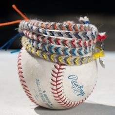 At the core of of every Major League Los Angeles Angels baseball there are 130 yards of usable wool yarn. After carefully unwinding the cores, the cream & light gray strands, along with a bamboo cord, can be braided into this subtly stylish bracelet. Braided by hand in California from a game used MLB ball. Pittsburgh Pirates Game, Cincinnati Reds Game, Pittsburgh Sports, Yarn Friendship Bracelets, Yarn Bracelets, Boston Red Sox Game, Chicago White Sox, Washington Nationals Game, Blue Jays Game