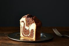 This is not the marble cake of your childhood!  Even if the cake of memory was delicious, this one is hipper, super simple to make, and gorgeous without your doing anything special to make it so.  The batter is made with flavorful extra virgin olive oil, a hint of white pepper, and natural cocoa powder.  The tiger stripe marbling happens magically, all by itself, while the cake is baking; all you have to do is layer the batters into the pan.