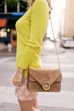 Add a luxurious touch to your look with our brown Italian suede purse with  chic gold f13cb42c18