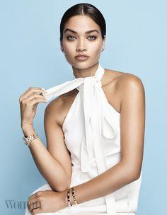 Shanina Shaik poses in Cartier jewelry with white Chloe dress