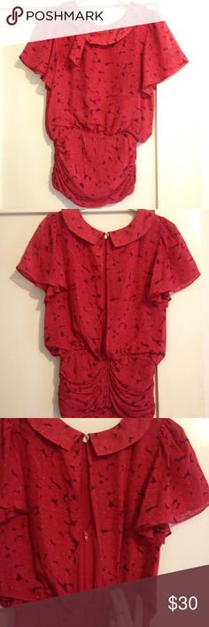 Red floral blouse Peep hole in the back. Zips up and one button at neck. Scrunch as bottom is very flattering. Urban Outfitters Tops Blouses