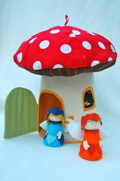 A sewing pattern to make this house and the fairies. There are days I wish I lived in a soft mushroom house.