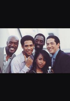"""Found this pic on the internet. I've never seen it before but maybe you guys have. But anyway this is the set of Aaliyah's first movie """"Romeo Must Die"""". Her brother Rashad is in the pic.( 2nd person to the left). Whose birthday is tomorrow August 6."""