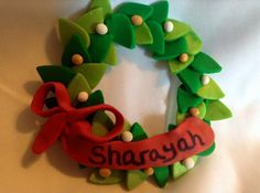 These pretty polymer clay wreaths measure approx. 3x3x1/4 and will hang almost anywhere. They can be personalized and are great for those with