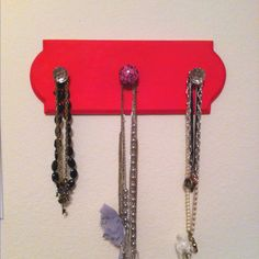 Necklace rack with drawer knobs
