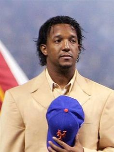 Pedro Martinez with a 21st century curl. Boston Redsox. New York Mets