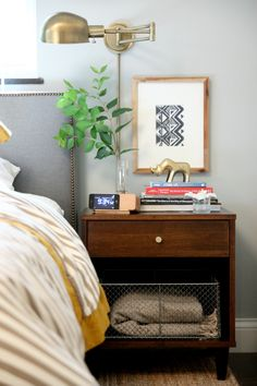 Another Dana Miller photo - this time the combination of dark nightstand, gold accessories and mustard yellow highlights.