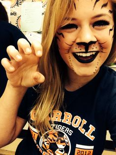 My daughter, Katie Day, with her version of Tiger make-up.  Pretty awesome!