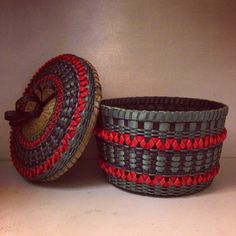 Large teal-ish grey, black and coral colored black ash and sweetgrass basket made by Mohawk basket maker, Ann Mitchell.