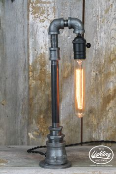 Steampunk Industrial Machine Age Lamp Handcrafted from a variety of electrical and plumbing components, this eclectic machine age lamp offers sleek steampunk style in a design that is sure to blend pe