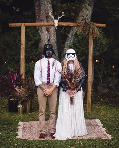Bride and groom in stormtrooper masks at their fun Star Wars themed wedding!