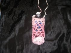 "Crocheted water bottle holder in cotton. The string is long enough to wear as a cross body to keep your hands free and the cotton absorbs the ""sweat"" from the cold drink. Available in pink and blue varigated, $5"