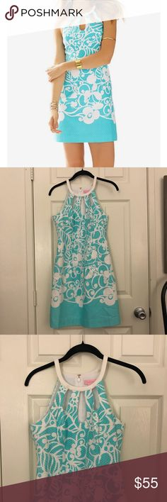 Lilly Pulitzer The Pearl Shift Dress size 0 Lilly Pulitzer The Pearl Shift dress with cut out neckline in Shorley Blue Pattern  Size 0 Has a couple of minor flaws . A small stain on the collar and needs a stitch on one of the straps. Lilly Pulitzer Dresses
