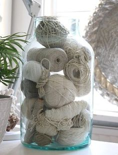 cheap + chic decor idea: use balls of string and twine as vase filler by kristym28