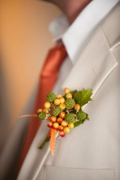 Raspberries and Ilex combine for a wonderful boutonniere.
