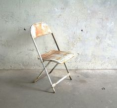 Vintage metal folding chair, white, rusty & worn, aged finish & still structurally sound. Well made & sturdy