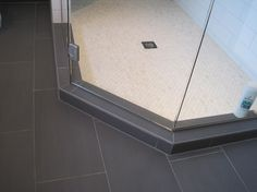small bathroom, dark bathroom floor and light shower tile