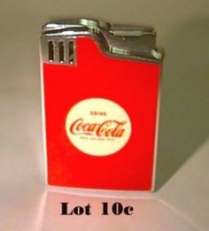 CIGARETTE LIGHTER .. COCA COLA    http://www.burchardgalleries.com/auctions/1998/mar2298/l010c.jpg