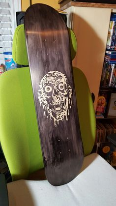 Who doesnt love cult classic horror films, i know i do. This is a custom stenciled tar man from return of the living dead. This was done on a blank skate deck and has a dark purple stain.