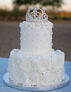 White Rosette and Quilt with Tiara - Six inch over Ten inch buttercream with rosettes and quilted finish with pearl buttons.  Tiara is made from gum paste painted with platinum and pearls.