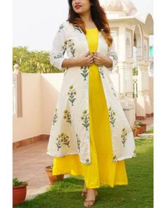 Shop online Set of yellow maxi with block printed jacket This bright set of yellow sleeveless maxi dress and block printed jacket is sure to cheer you up this spring. Kurta Designs Women, Kurti Neck Designs, Blouse Designs, Dress Designs, Indian Designer Outfits, Indian Outfits, Designer Dresses, Shrug For Dresses, Indian Gowns Dresses