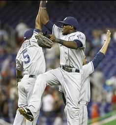 Game #102 7/27/12: San Diego Padres players Alexi Amarista (5) and Cameron Maybin celebrate after a baseball game in Miami, Friday, July 27, 2012 against the Miami Marlins. The Padres won 7-2. (AP Photo/J Pat Carter)