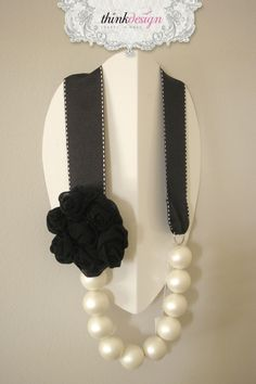 Long pearl necklace with ribbon, decorated with rose pin. Interested in buying?  Please contact @ my_thequill@yahoo.gr
