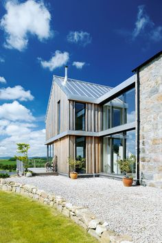 The larch extension has floor to ceiling windows looking out onto the garden and countryside